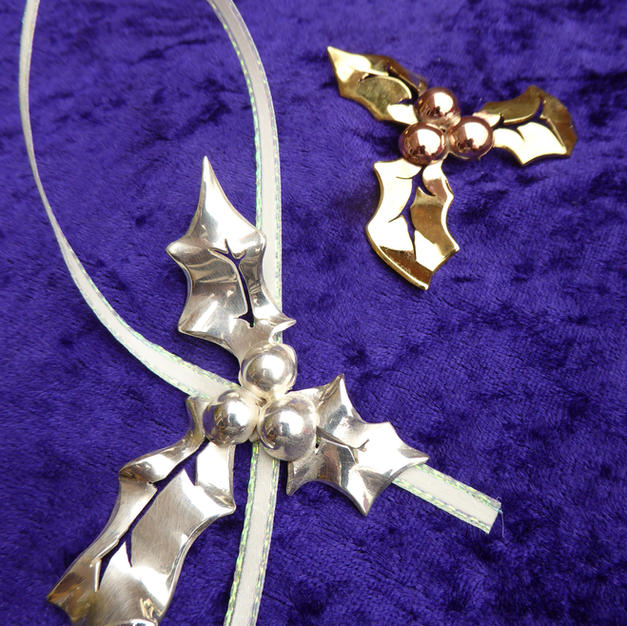 Silver and brass holly