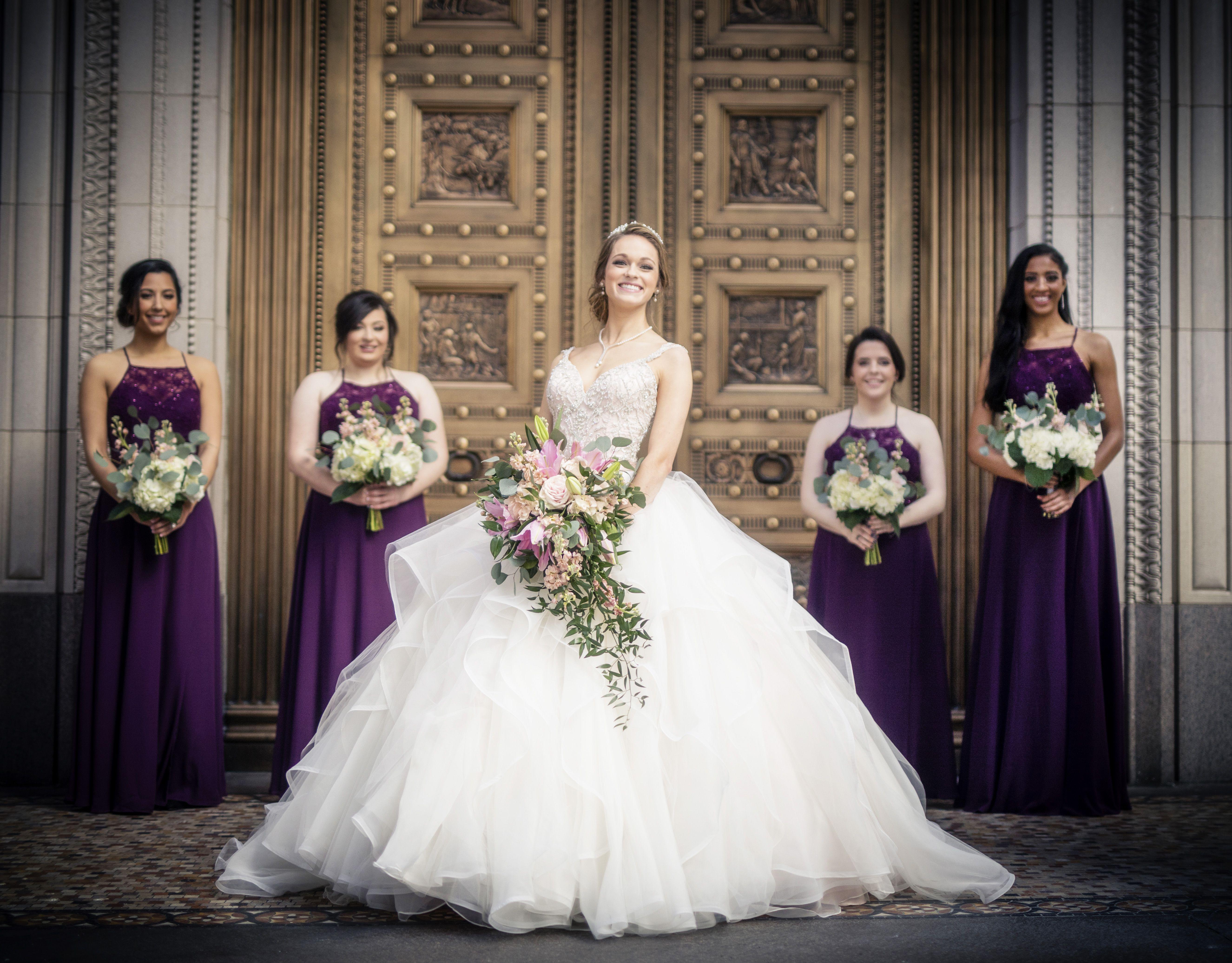 Bridesmaids in front of gold doors