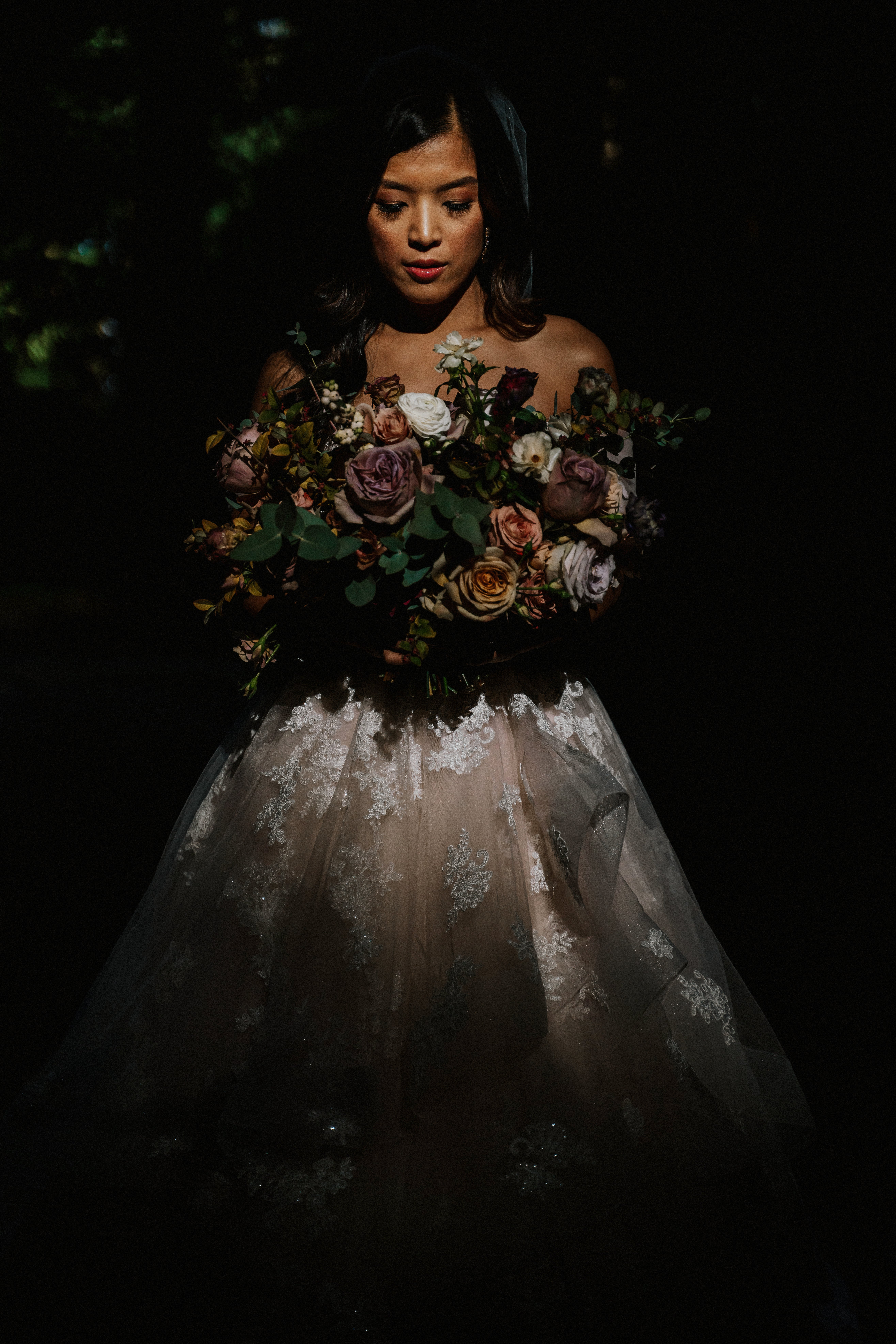 portland bride holds bouquet