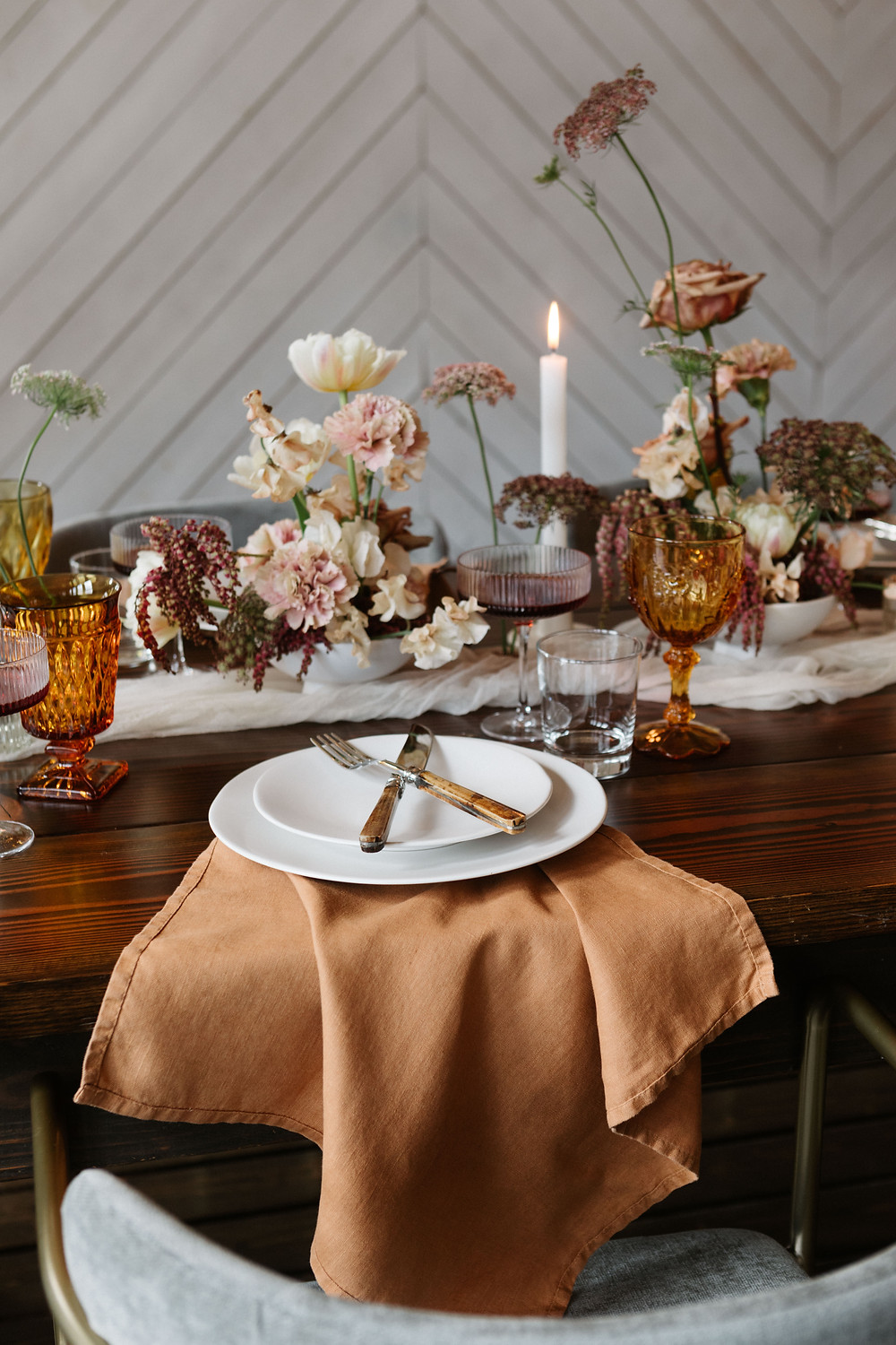 A mid-century modern tablescape with linen, chifrron, and vintage glasses