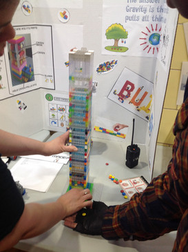 Teacher and student building tower with