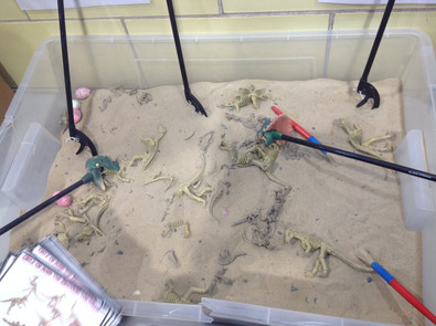 Animal toys in sand