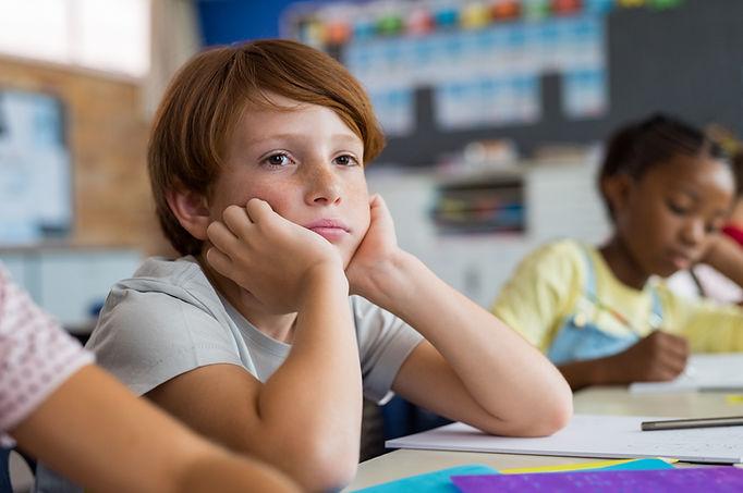bored-school-boy-in-class-PT64EDK.jpg