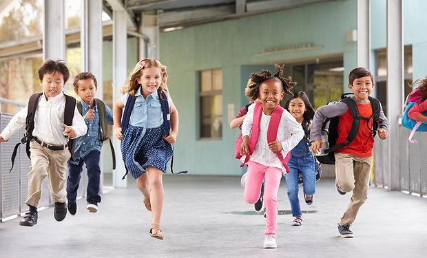 group-of-elementary-school-kids-running-