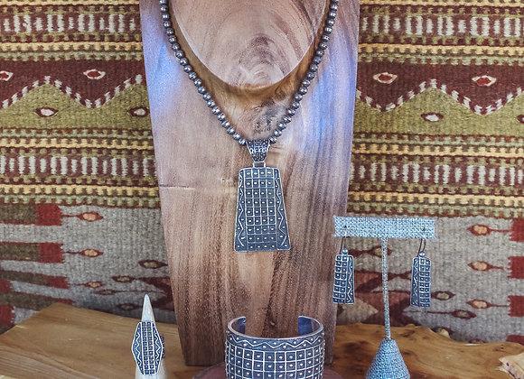 Navajo Tufa Cast Silver Set