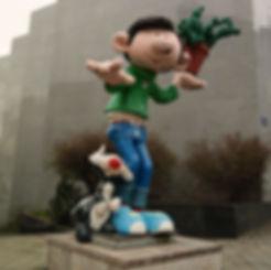 Gaston Lagaffee statue near The Belgian Comic Strip Center