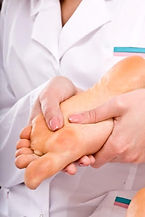 Osteopath holding patient's foot