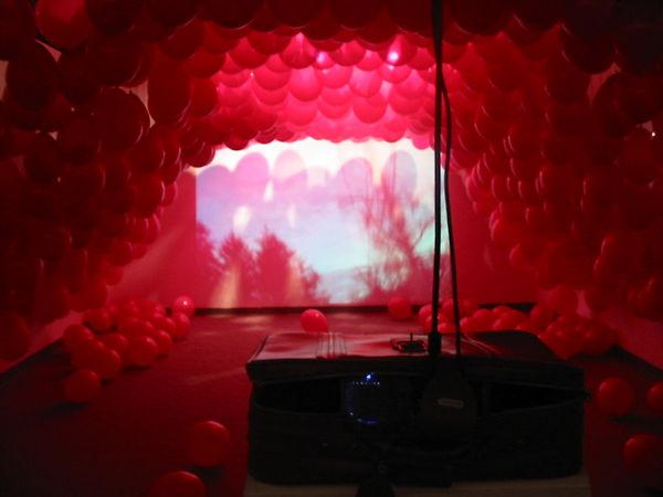 behind projector