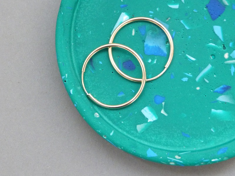 Rolled gold creole hoops on trinket tray