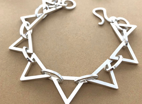 Bespoke silver triangle bracelet commission