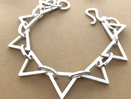 Bespoke silver triangle bracelet commission