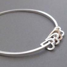 Elin-Horgan-silver-gold-earts-bracelet.j