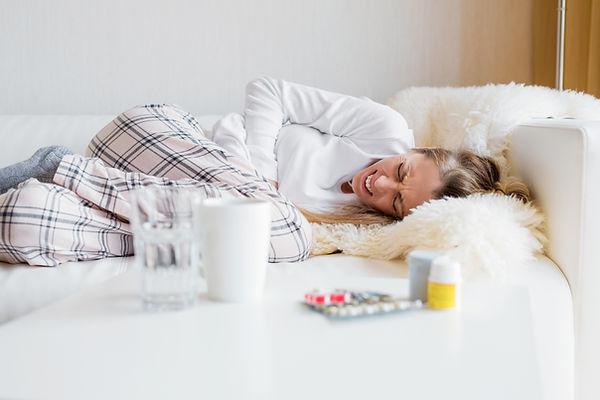 Woman having stomach cramps.jpg