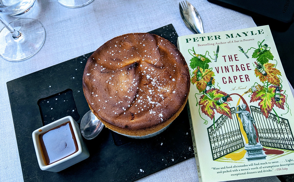 Soufflé with a book lying beside it