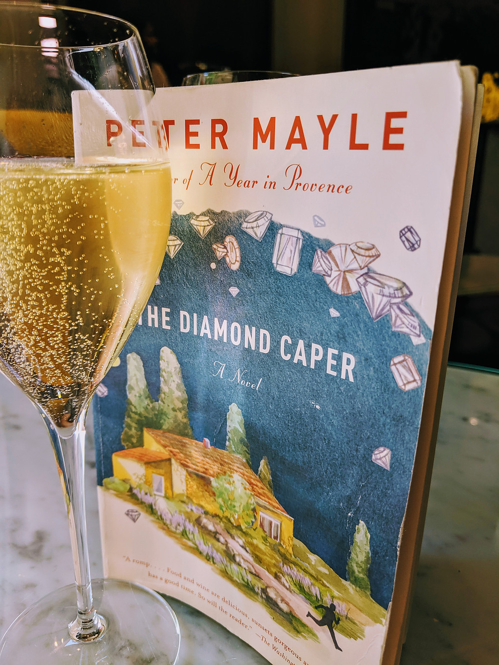 A glass of champagne and a book