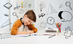 education, childhood, people, homework and school concept - smiling student boy with book writing to