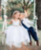 flower girl and ring bearer on swing.jpg