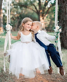 flower girl and ring bearer on swing.jpg
