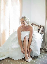 caylie in bridal suite in chair.jpg