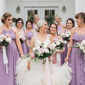 hayley with bridesmaids in front of hous