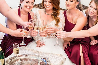 jayme in bridal suite with champagne.jpg