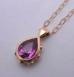 Pink pear sapphire with diamonds in 18ct