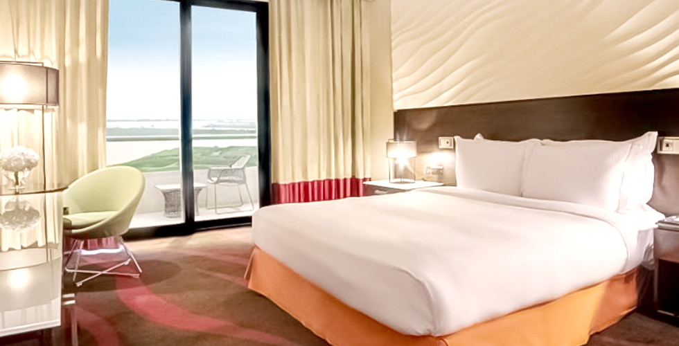 Staycation Offer for 2 Days & 1 Night Stay at 4* Radisson Blu Hotel, Abu Dhabi Yas Island with free access to any 1 park either Ferrari World, Yas Water World or Warner Bros from AED 1,045