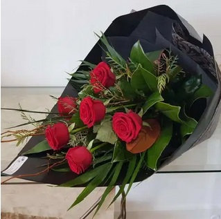 Lush Red Roses with foliage