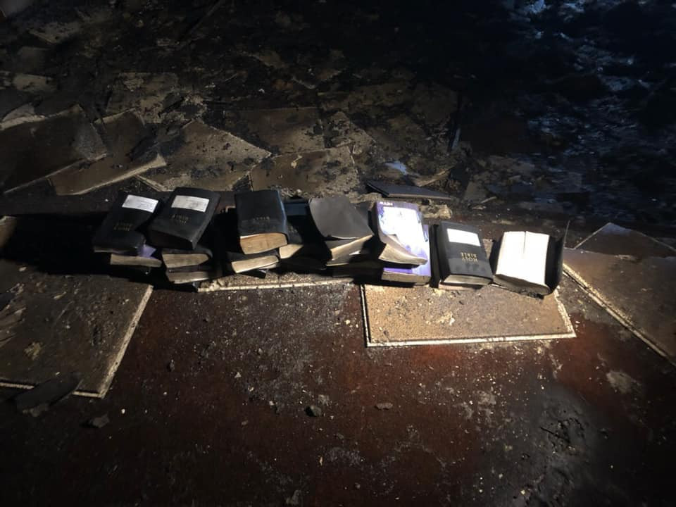 The Coal City Fire Department shared a photo of several Bibles in a pile on the floor of the church.