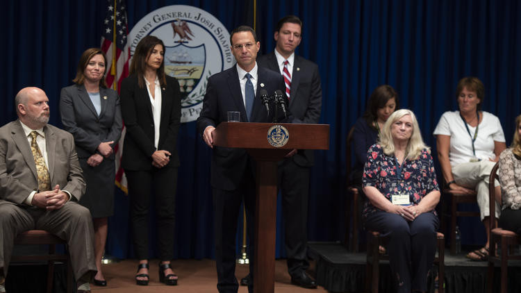 Pennsylvania Attorney General Josh Shapiro stands among victims and staff as he holds a press conference. (Rick Kintzel/The Morning Call)
