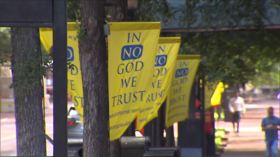 In No God We Trust banners in downtown Fort Worth (CBS 11)