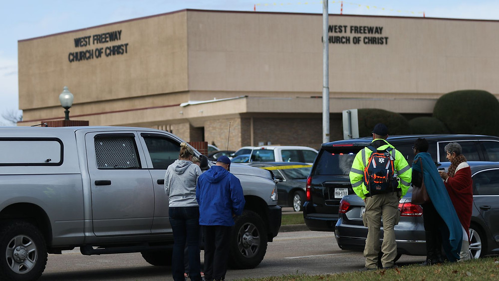 People gather outside the West Freeway Church of Christ in White Settlement on Sunday. (Juan Figueroa / Dallas Morning News)