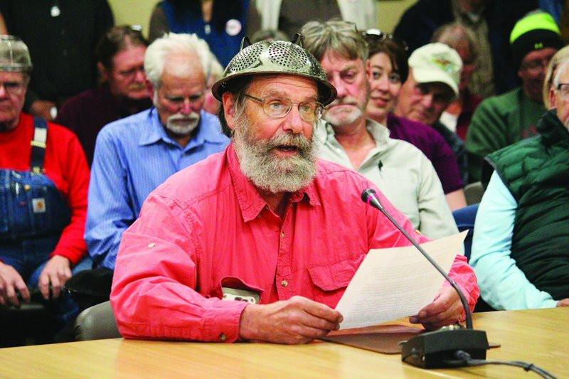 Barrett Fletcher delivers his invocation on Tuesday. (Megan Pacer/Homer News via AP)