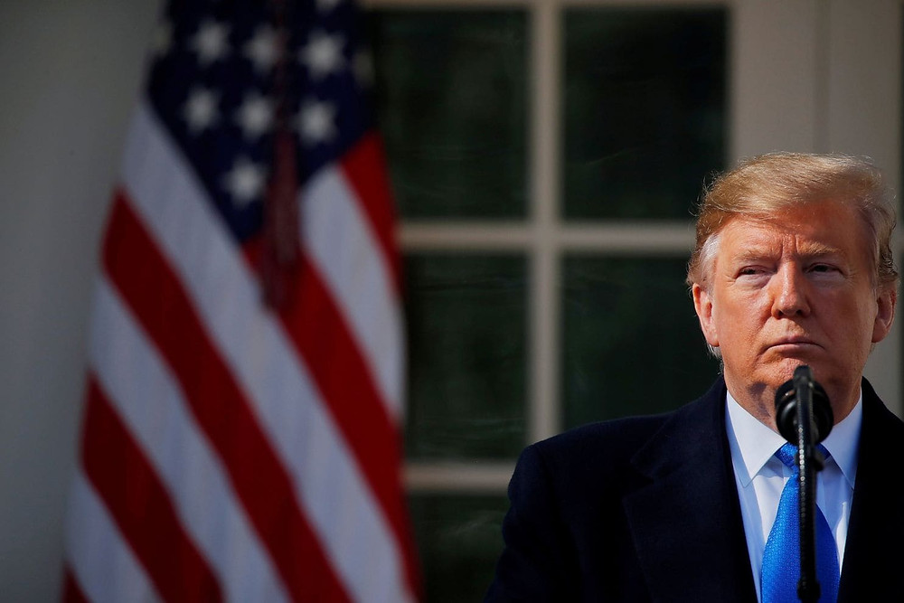 President Trump speaks in the Rose Garden of the White House in Washington on Feb. 15. (Carlos Barria/Reuters)