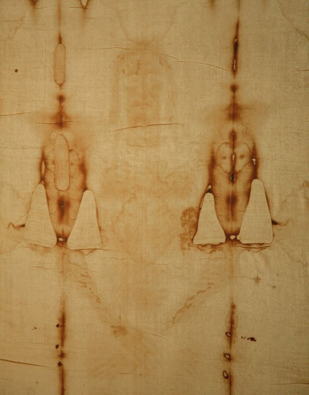 A section of the Shroud of Turin supposedly showing an image of Jesus Christ's face and torso.
