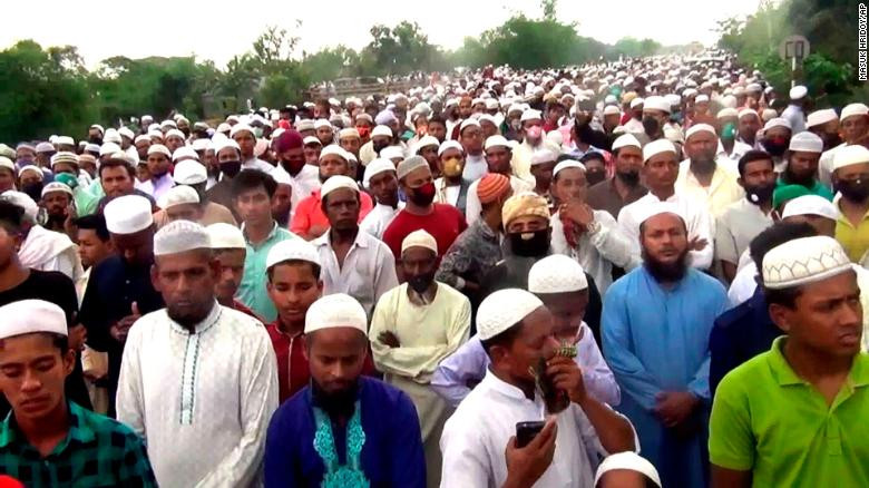 Thousands of Bangladeshi Muslims gather for the funeral of a popular Islamic preacher on Saturday, April 18, 2020. (CNN)