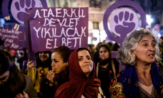 Protesters hold a banner reading 'Women resist male domination' as they march in Istanbul in 2016, when a similar bill was proposed. [Ozan Köse/AFP via Getty Images ]