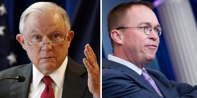 Jeff Sessions is the elfin-eared asshole on the left, and Mick Mulvaney the asshole on the right.