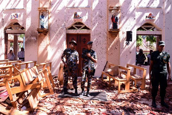 Soldiers at the scene of the bombing at St. Sebastian's Church in Negombo, Sri Lanka, on Sunday. STRINGER / AFP - Getty Images
