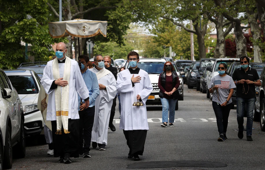 A procession called the Blessed Sacrament being performed in Queens, NY. (Mike Segar/Reuters)