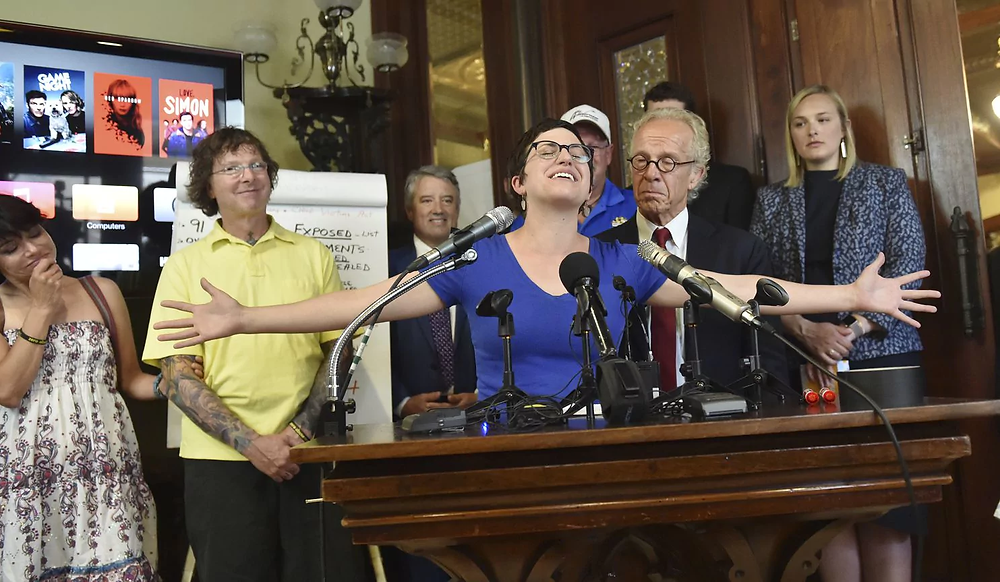 Marie Mielke speaks at a press conference yesterday about the settlement.