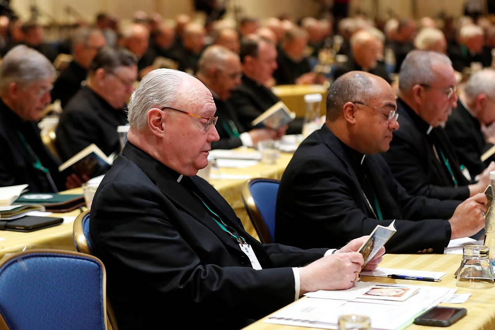Bishops and other attendees participate in prayer at the U.S. Conference of Catholic Bishops in Baltimore. PHOTO: KEVIN LAMARQUE/REUTERS