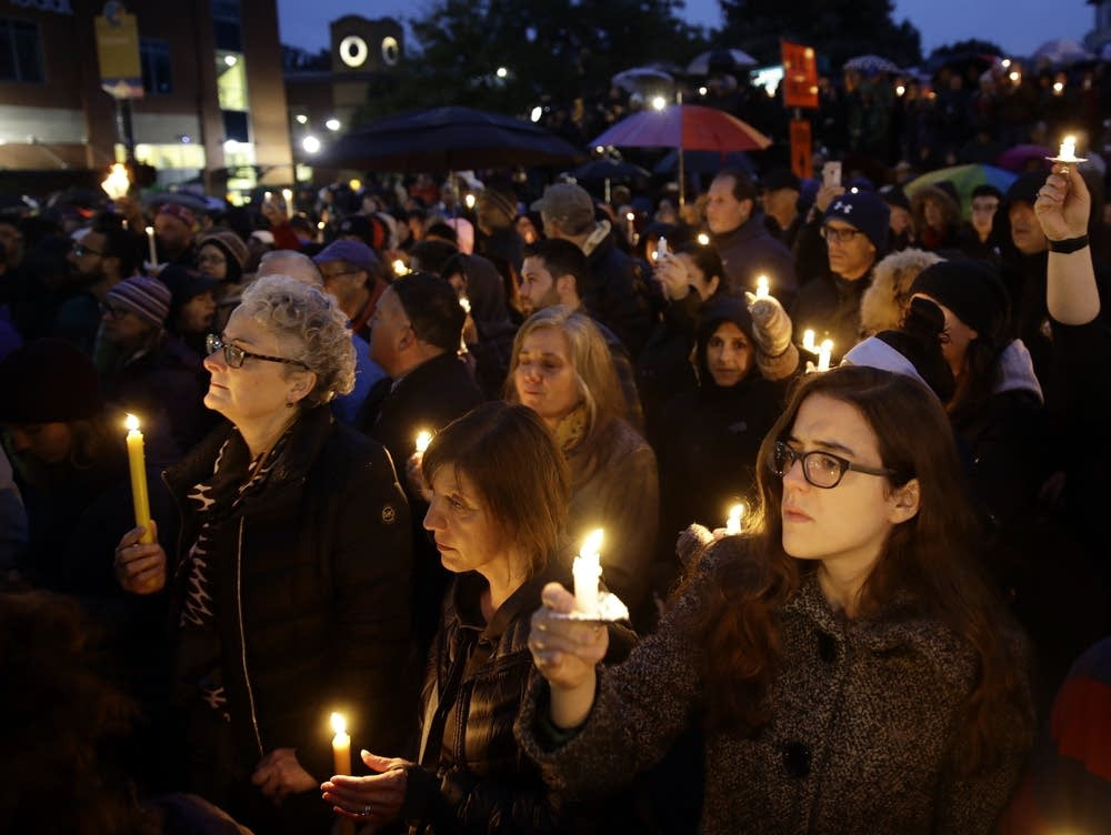 People hold candles as they gather for a vigil in the aftermath of a deadly shooting at the Tree of Life Congregation, in the Squirrel Hill neighborhood of Pittsburgh, on Saturday. Matt Rourke | AP