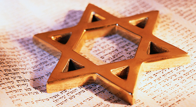 A Star of David rests on Jewish scripture.