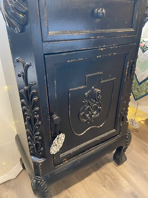 Chippy black cabinet with drawer