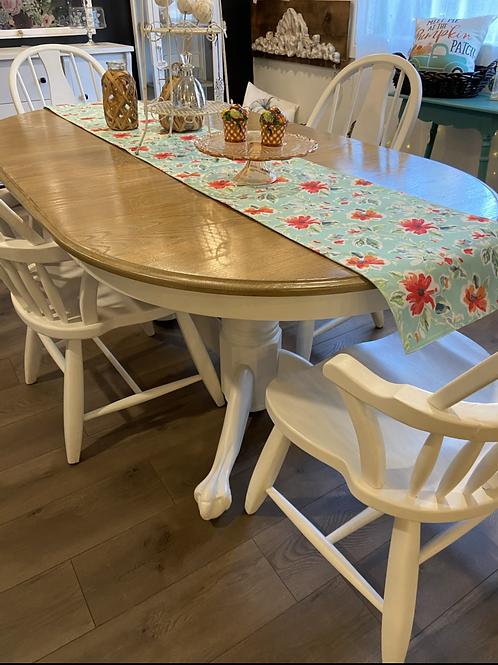 White farmhouse trestle table with four chairs