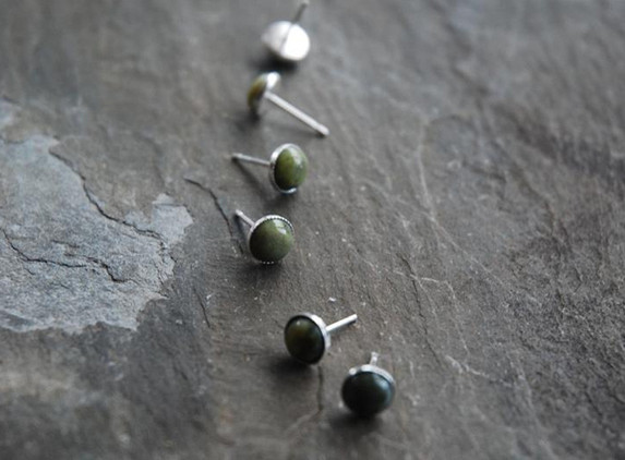 sterling-silver-small-ear-stud-set-with-6-mm-connemara-marble