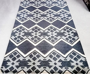 Geometric hand tufted wool rug by rugsusv