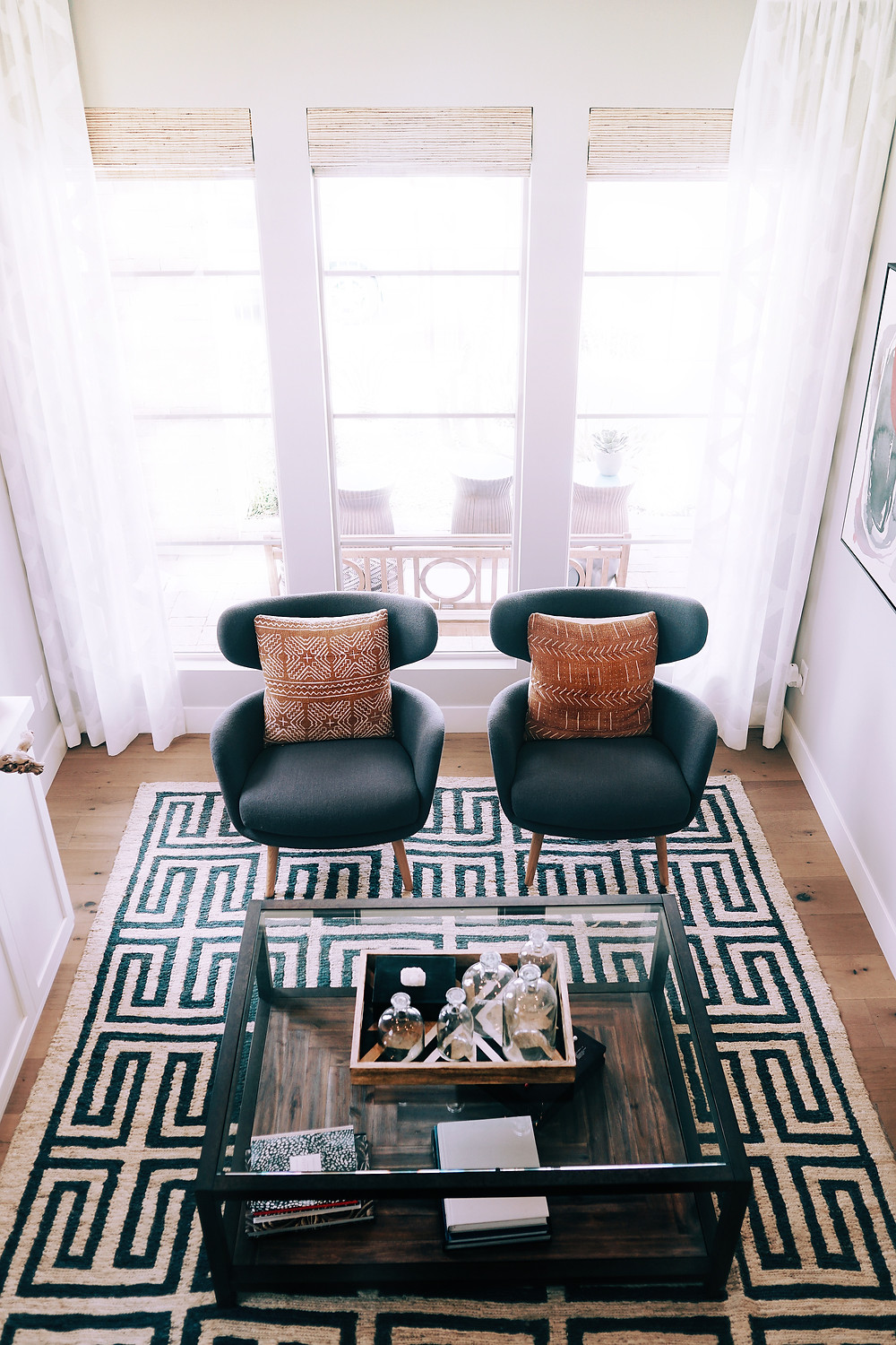 Rug placed in living room; Black and White; Geometric Pattern; Clean and Sophisticated Vibe