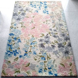Floral hand tufted floor covering rug